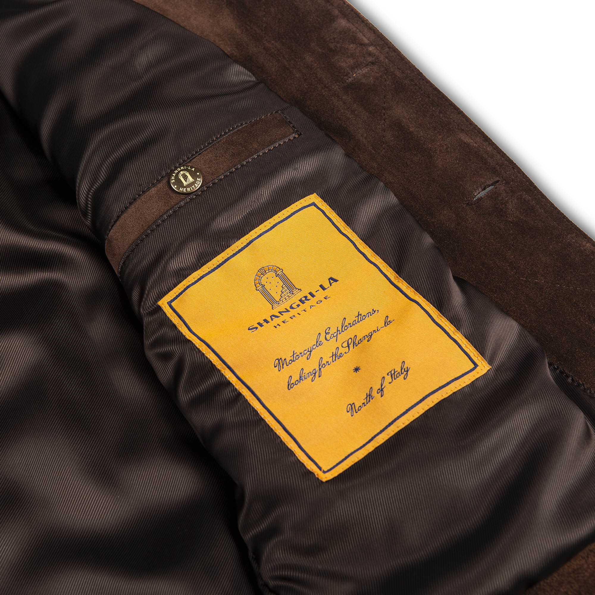 shangri-la-heritage-terracotta-brown-calfskin-suede-jacket-still-life-front-pocket-label