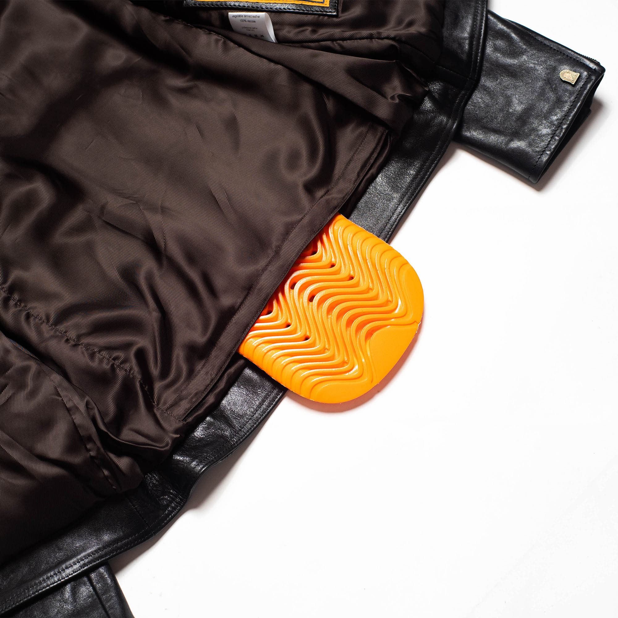 shangri-la-heritage-cafe-racer-black-lambskin-leather-jacket-still-life-back-armor-pocket