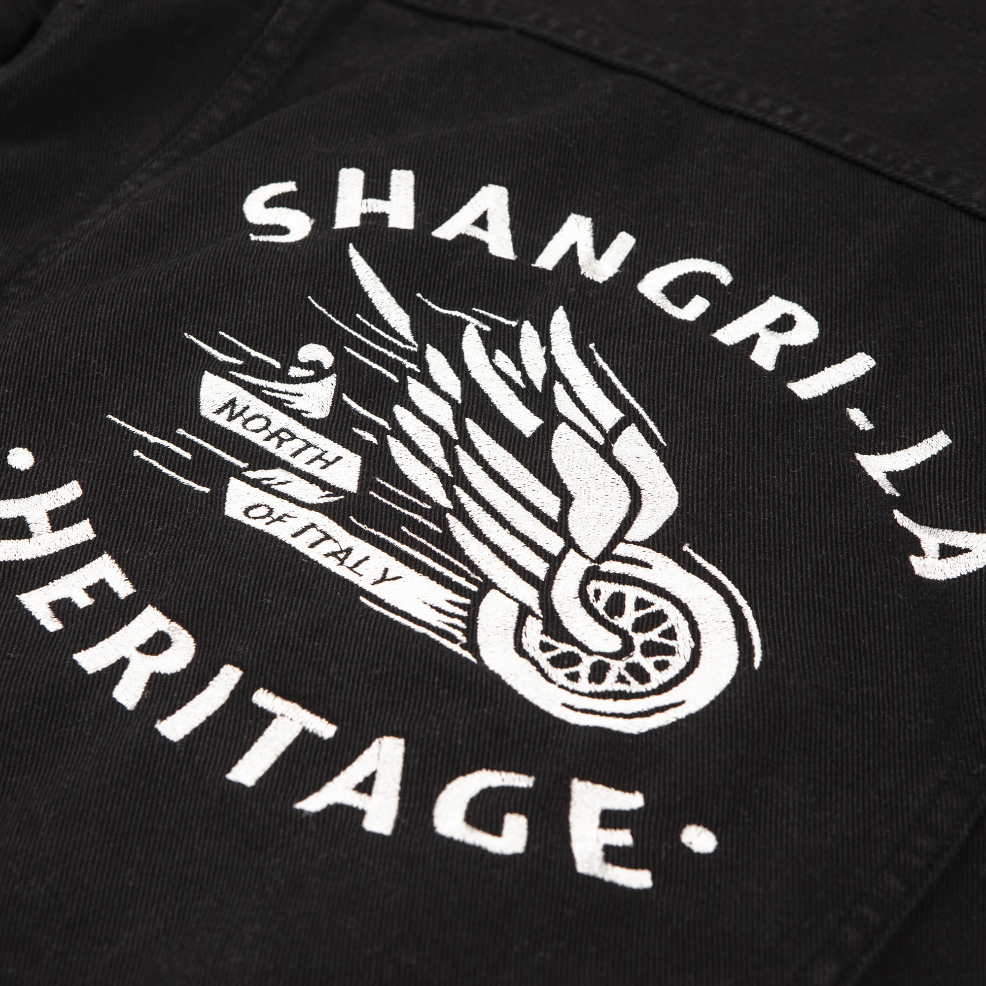 shangri-la-heritage-new-single-rider-winged-wheel-black-canvas-jacket-still-life-ebroidery-detail
