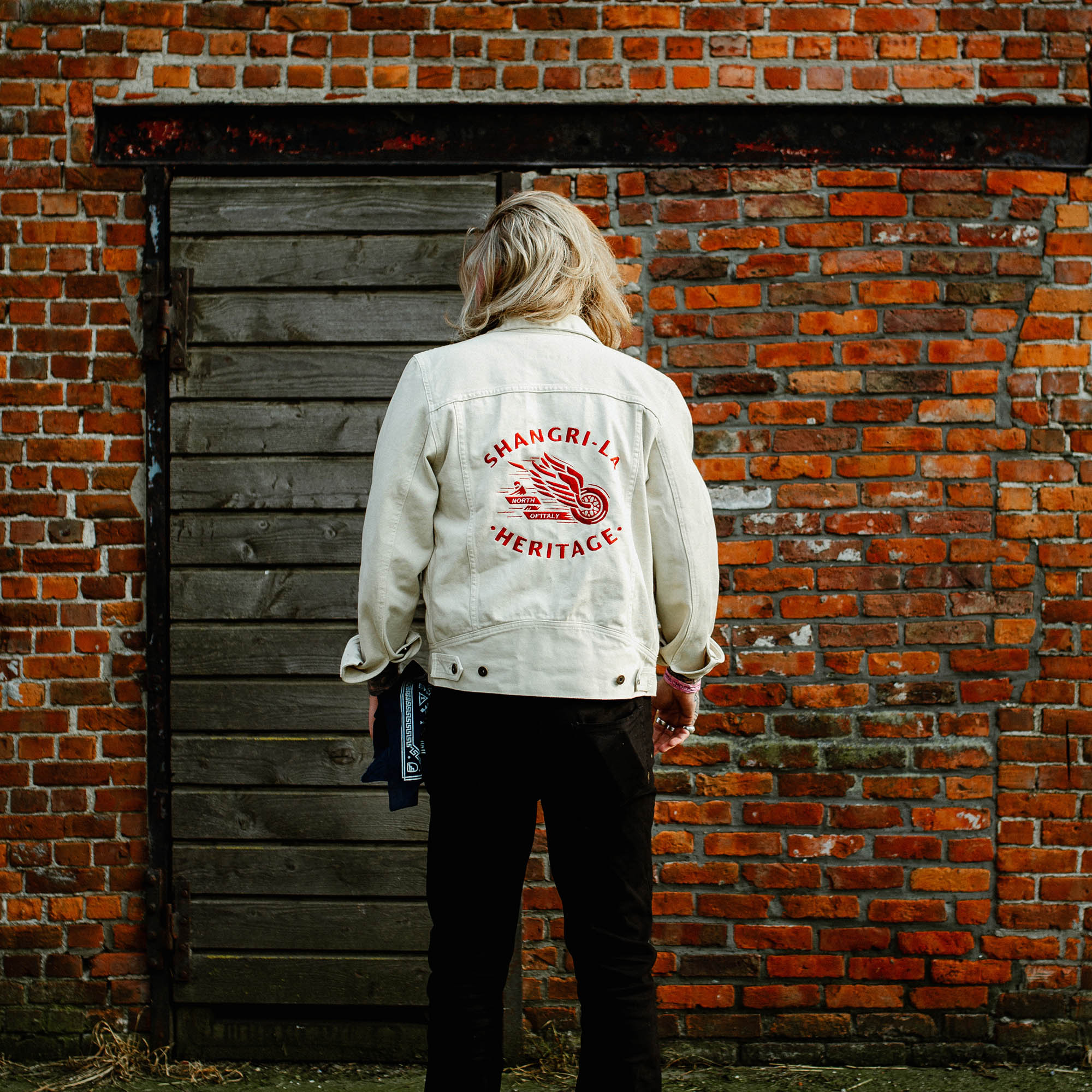 shangri-la-heritage-new-single-rider-winged-wheel-ivory-canvas-jacket-lifestyle-3