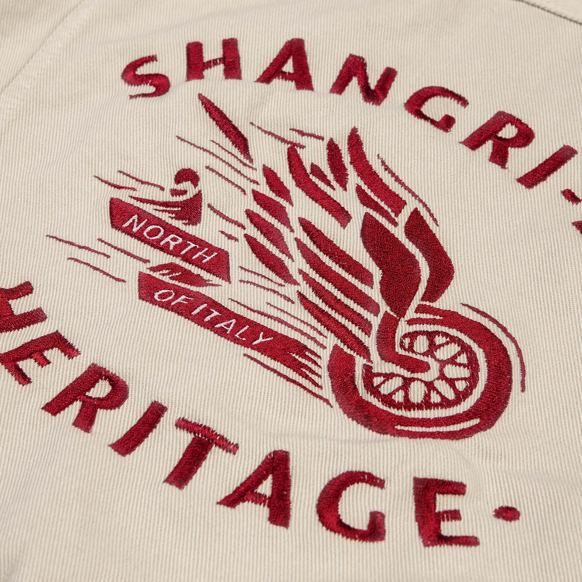 shangri-la-heritage-new-single-rider-winged-wheel-ivory-canvas-jacket-still-life-ebroidery-detail