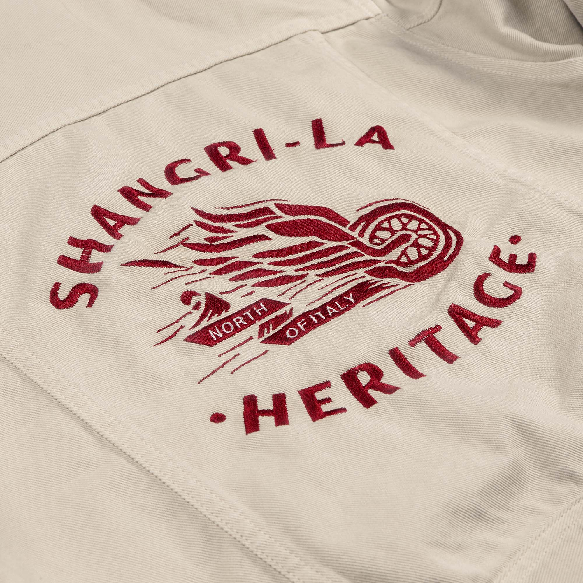 shangri-la-heritage-new-single-rider-winged-wheel-ivory-canvas-jacket-still-life-embroidery