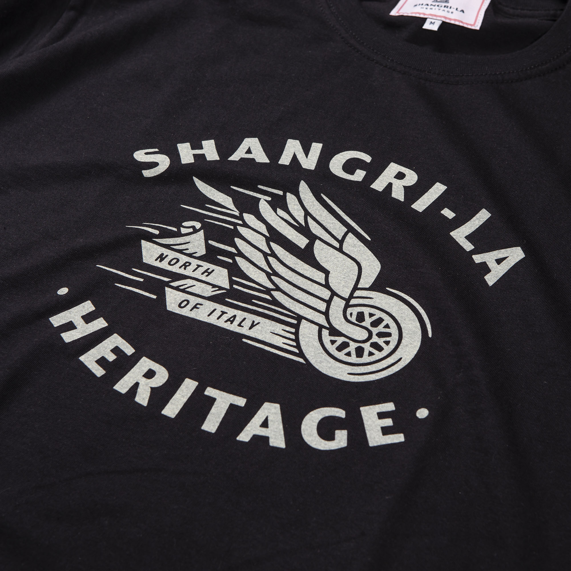 shangri-la-heritage-winged-wheel-black-tee-ivory-print-detail