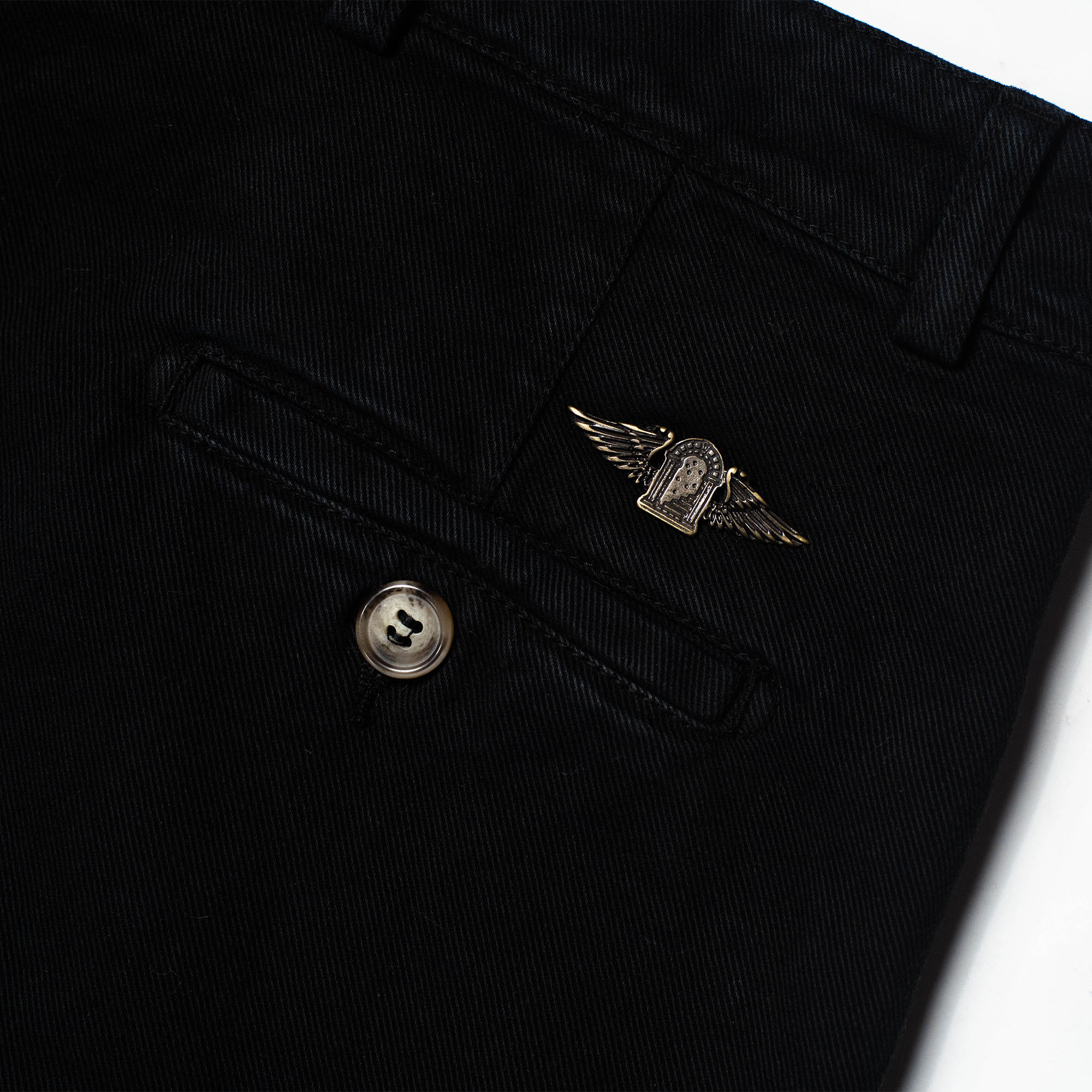 shangri-la-heritage-explorator-black-cotton-twill-pants-still-life-back-pocket-logo