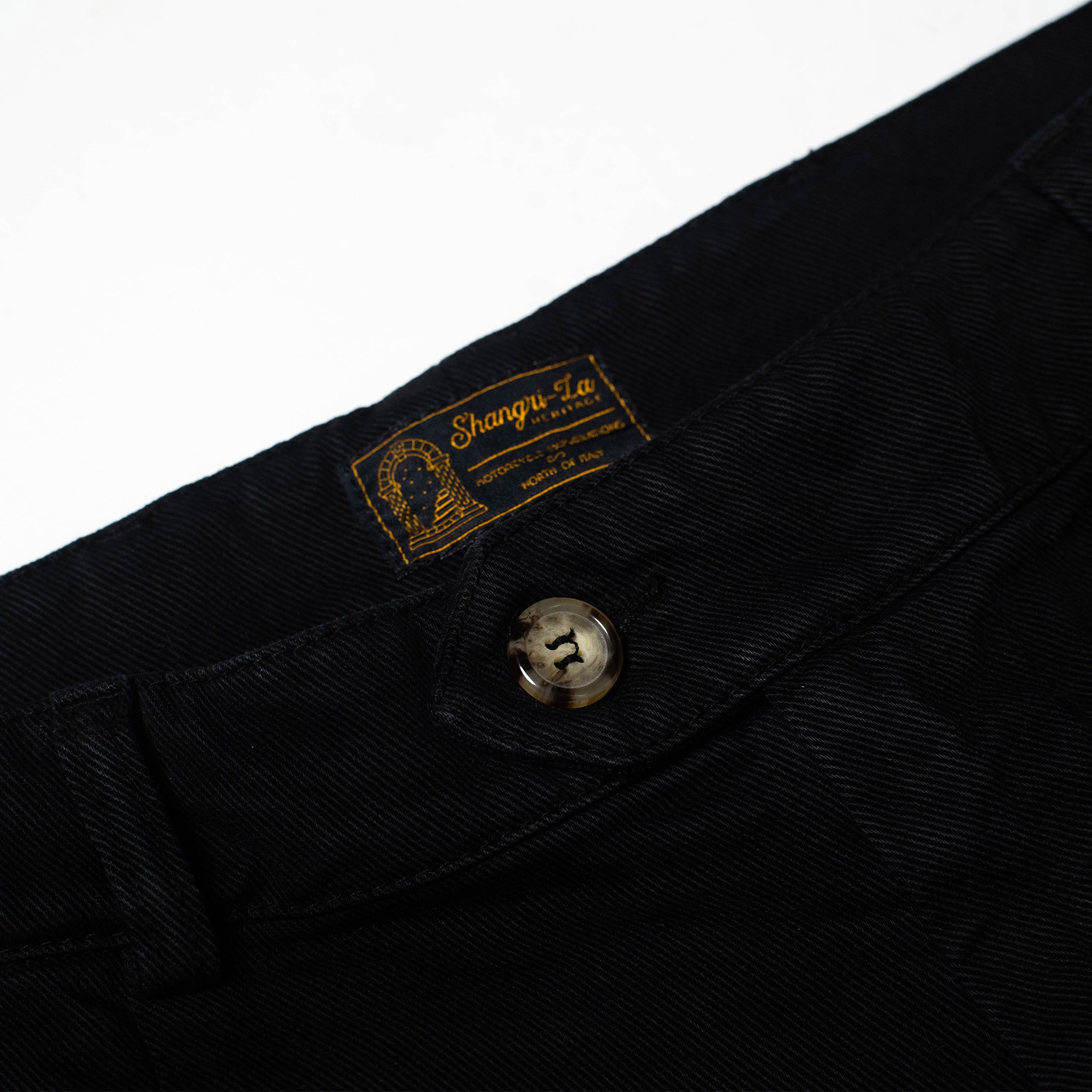 shangri-la-heritage-explorator-black-cotton-twill-pants-still-life-label