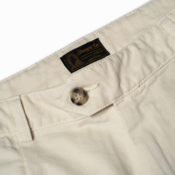 shangri-la-heritage-explorator-white-cotton-twill-pants-still-life-label