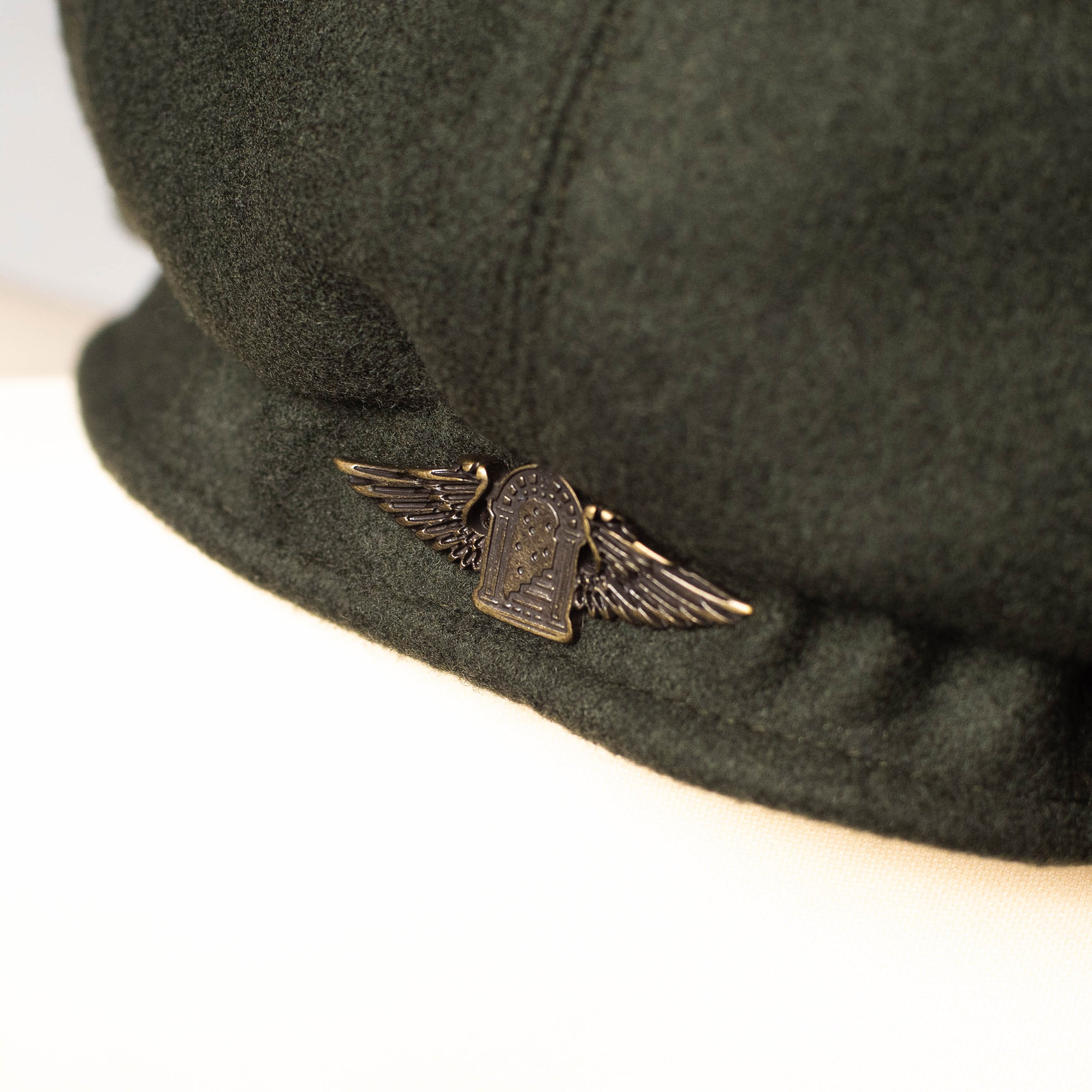 shangri-la-heritage-outlaw-forest-green-wool-8-panel-riders-cap-still-life-logo